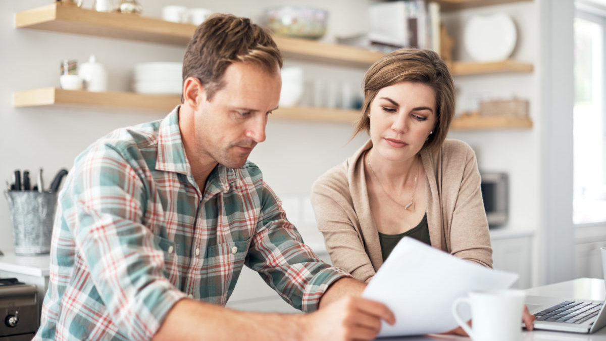 Couple looking at fine print