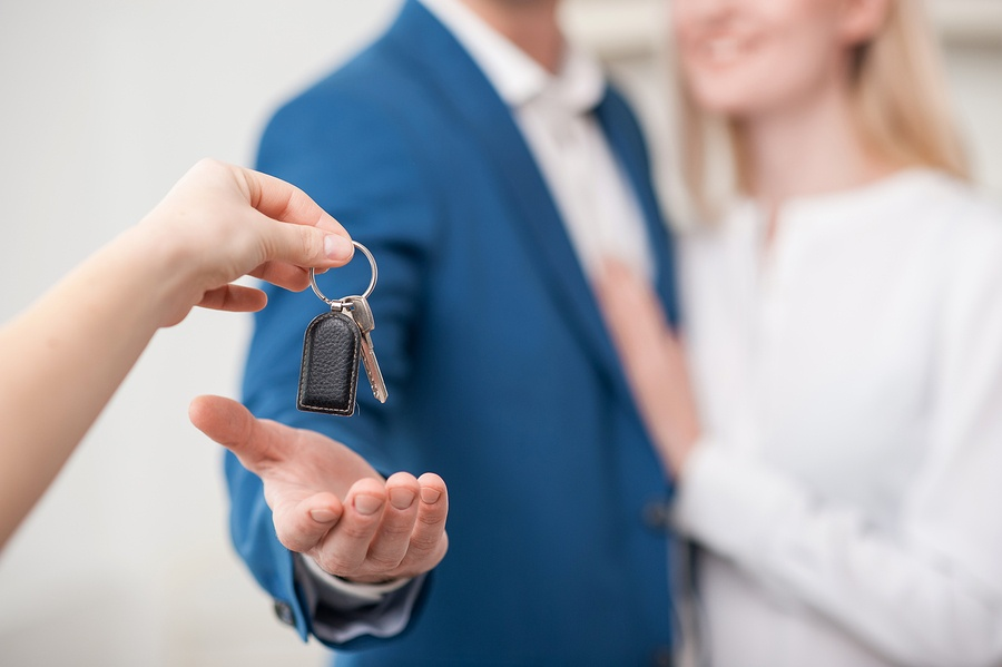 Handing keys to property buyers at close of sale